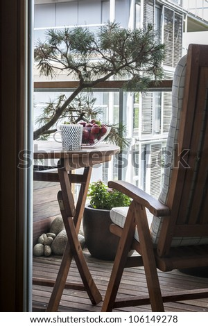 Wooden table with fruits and tea on home terrace - stock photo