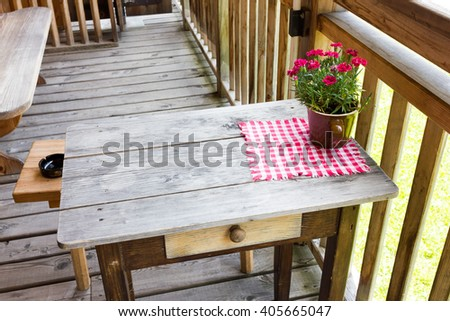 Wooden table with vase of flowers