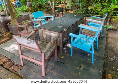 Wooden tables and chairs in the garden.