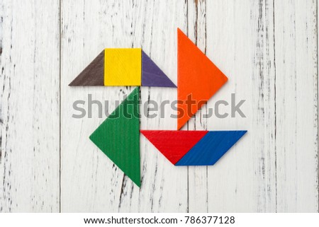 wooden tangram in a pinwheel shape