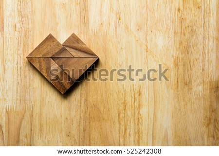 Wooden tangram puzzle in heart shape