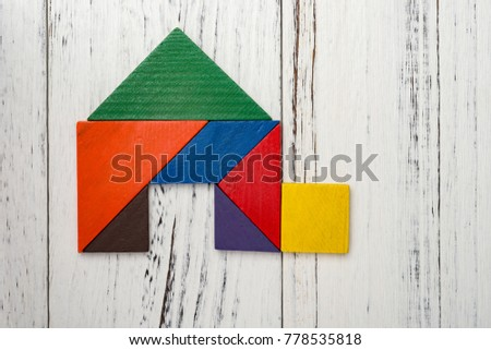 wooden tangram shaped like a house