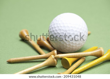 Wooden Tee and the Golf Balls
