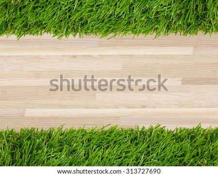 Wooden texture and green grass background.