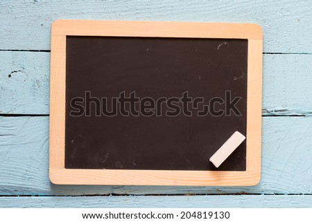 Wooden texture background, blackboard ( chalkboard ) texture. Empty blank black chalkboard with chalk traces