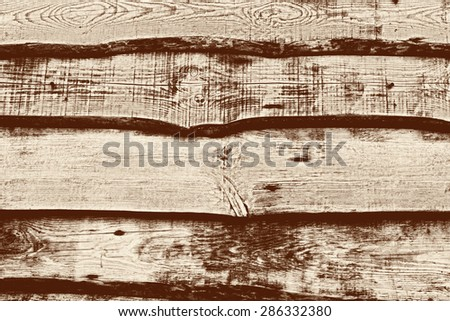 Wooden texture with scratches and cracks. It can be used as a background - stock photo