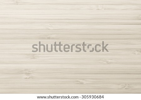 Wooden textured grainy detail backdrop in light sepia beige brown color tone: Bamboo wood laminated board detailed texture pattern background in sepia cream toned colour