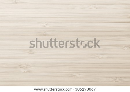 Wooden textured grainy detail backdrop in light sepia cream beige color tone: Bamboo wood laminated board detailed texture pattern background in sepia creme toned colour