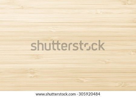 Wooden textured grainy detail backdrop in light yellow cream beige color tone: Bamboo wood laminated board detailed texture pattern background in yellow creme beige toned colour         - stock photo
