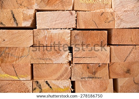 Wooden timber at a sawmill - stock photo