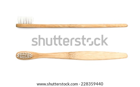 wooden toothbrush on white background - stock photo