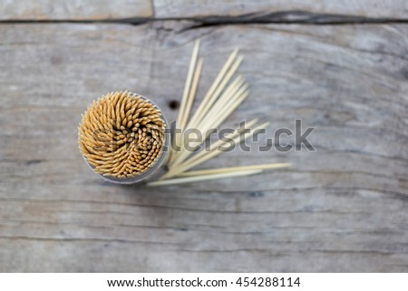 wooden toothpicks on wood background