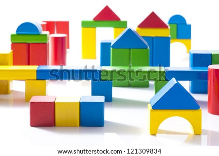 Wooden town made of colorful building blocks