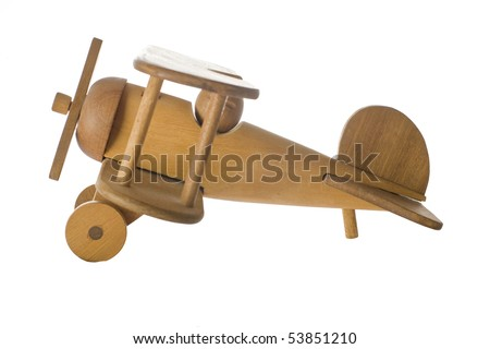 Wooden toy airplane isolated on white - stock photo