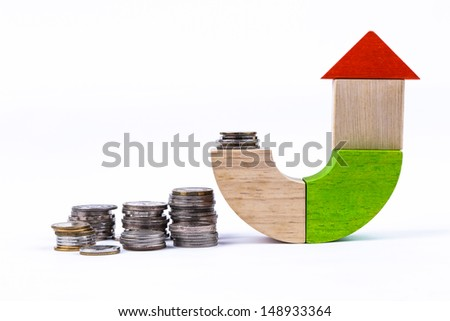 wooden toy and money, concept and ideas for house - stock photo