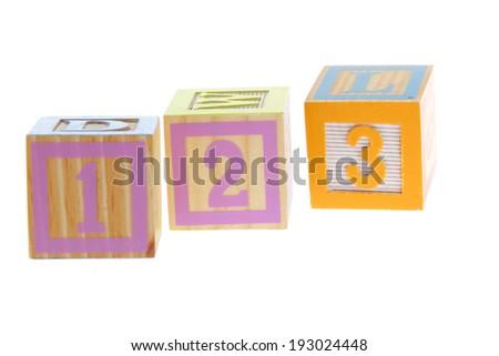 Wooden toy blocks on white background - stock photo