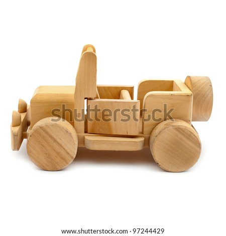 Wooden toy car on white background - stock photo
