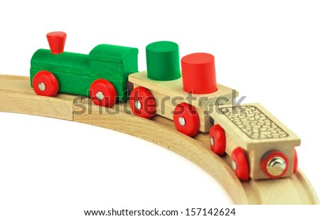 Wooden toy colored train isolated on white background  - stock photo