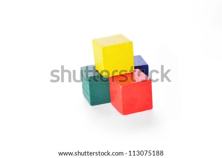 Wooden  toy cubes on white background