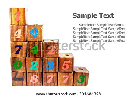 wooden toy cubes with letters. Wooden numeric blocks.  - stock photo