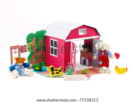 Wooden toy farm western style with farmer and there pets - stock photo