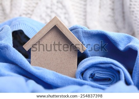 wooden toy house - the concept of housing purchase mortgage dollars cash money - stock photo