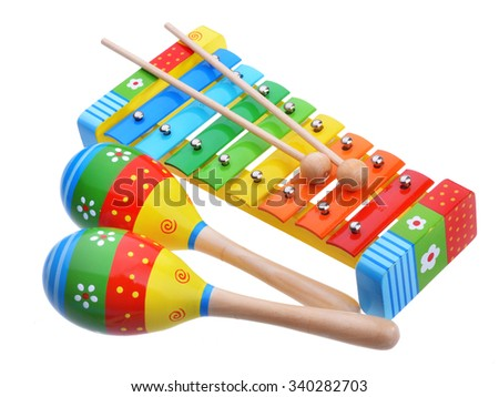 Wooden toy music instruments isolated on white background