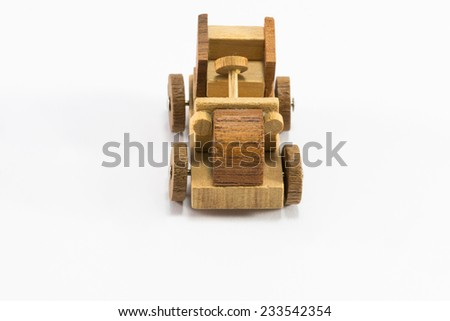 Wooden toy old car miniature isolated on white background - stock photo