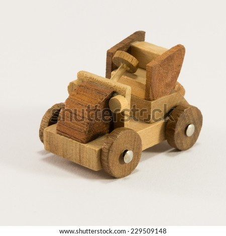 Wooden toy old car miniature on white background - stock photo