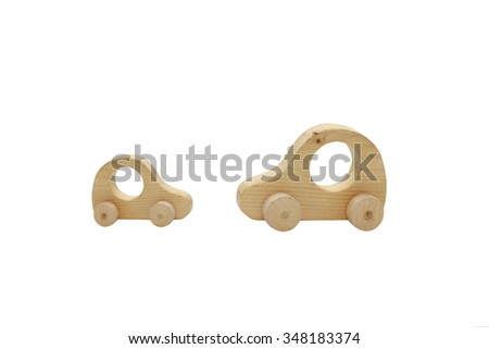wooden toy passenger cars. two wooden cars of the same type met up on the road. Big and small cars symbolize the continuity of generations. Isolated on white background - stock photo