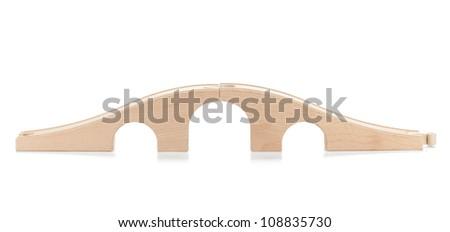 Wooden toy railway bridge. Isolated on white background - stock photo