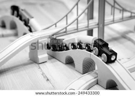 Wooden toy railway with bridges and train - stock photo