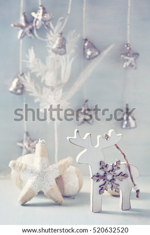Wooden toy reindeer for a Christmas tree .Christmas and New Year decoration.Christmas concept.