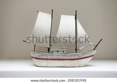 Wooden toy sail boat - stock photo