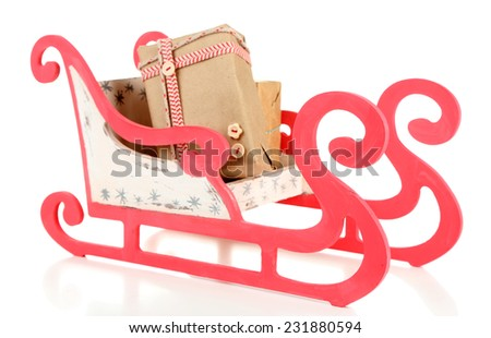 Wooden toy sledge with Christmas gifts, isolated on white - stock photo