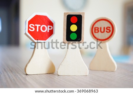 Wooden toy stop sign, traffic lights and bus stop sign