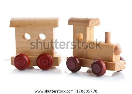 Wooden toy train on white background. Studio photo. - stock photo