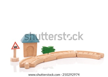 Wooden Toy train rail set with green glass and House on White Isolated Background - stock photo