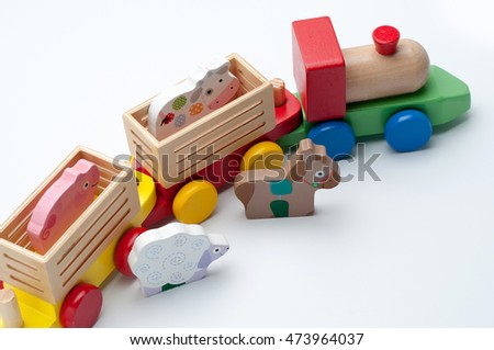 Wooden toy train with colorful blocks isolated over white.