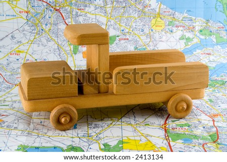 Wooden Toy Truck on Road Map - stock photo