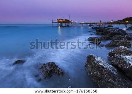 wooden Trabucco after sunset. - stock photo
