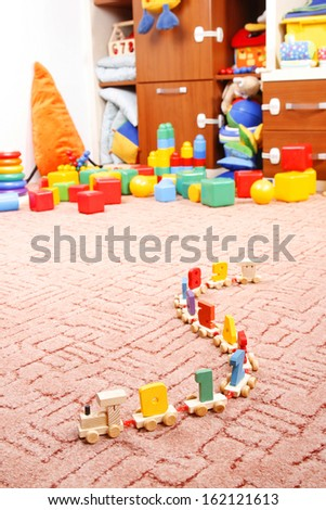 wooden train in room for children