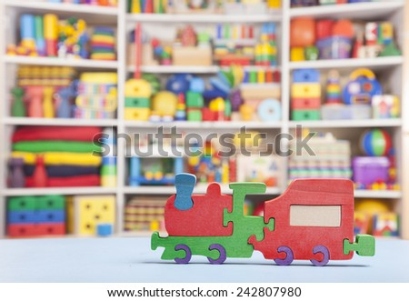 wooden train in room for children - stock photo
