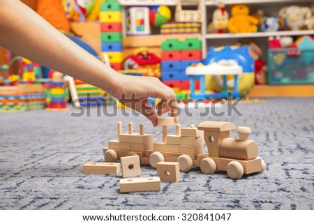 wooden train in the play room and many toys