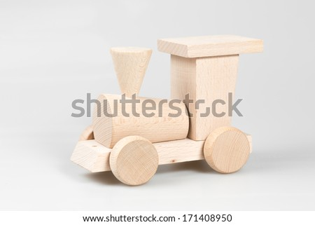 Wooden train on white background - stock photo