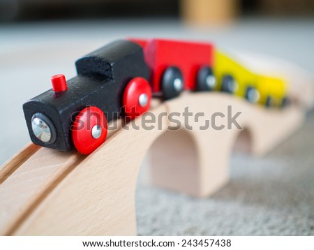 Wooden train over wooden bridge - stock photo
