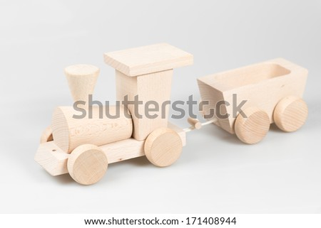 Wooden train with trolleys on white background - stock photo
