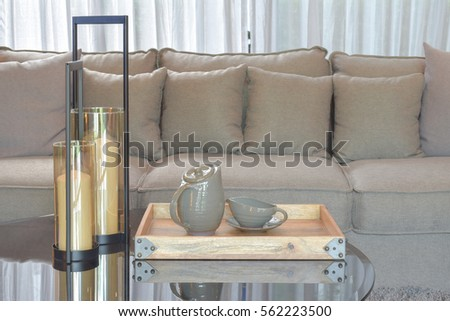 Wooden Tray With Pottery Tea Set And Candles On Glass Top Table Next To Sofa  In Part 97