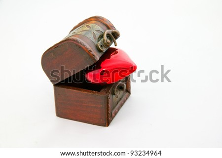 Wooden treasure chest with a red heart - stock photo