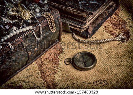 Wooden treasure chest with valuables. beads, necklaces and other jewelry - stock photo